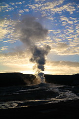 old faithful at sunrise - yellowstone