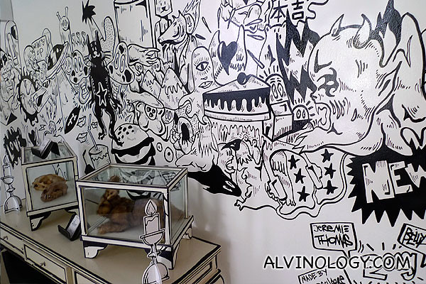 Black and white mural art on the wall