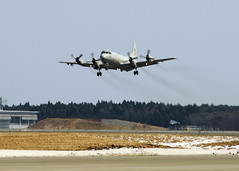 NAVAL AIR FACILITY MISAWA, Japan (March 29, 2011) A P-3C Orion aircraft from Patrol Squadron (VP) 4, also known as the Skinny Dragons, takes off from Naval Air Facility Misawa runway on one of the squadron's final missions while repositioned to the northeastern Japan base. (U.S. Navy photo by Mass Communication Specialist 1st Class Jose Lopez, Jr.)