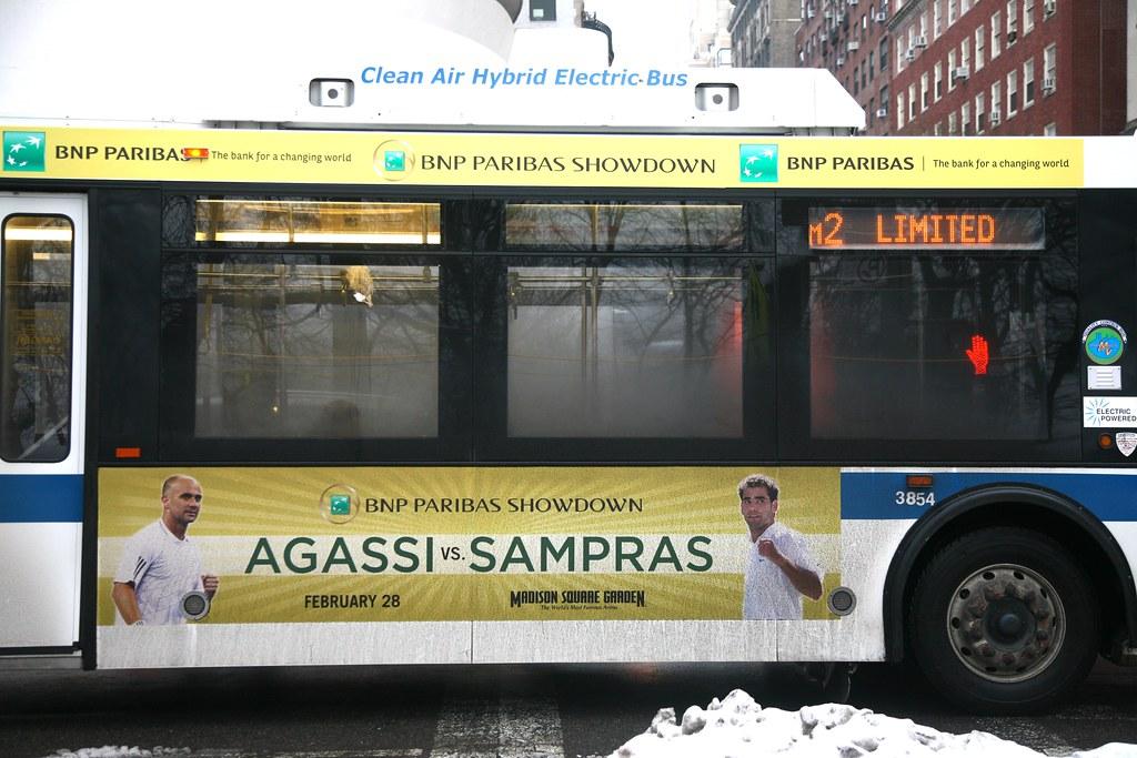 "New York City, Manhattan, Upper East Side, 5th Ave. : "" Clean Air Hybrid Electric Bus """