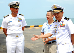 SIHANOUKVILLE, Cambodia (Feb. 26, 2011) Rear Adm. Ouk Seyha, commanding officer of Ream Navy Base, greets Capt. Bradley Lee, commander, Amphibious Squadron 11 during an opening ceremony for Maritime Exercise 11 (U.S. Navy photo by Mass Communication Specialist 2nd Class Eva-Marie Ramsaran)