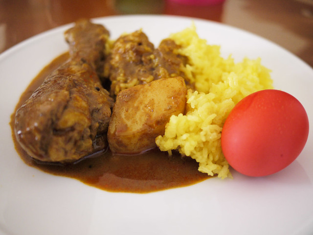 My plate: Chicken curry, yellow rice and red egg