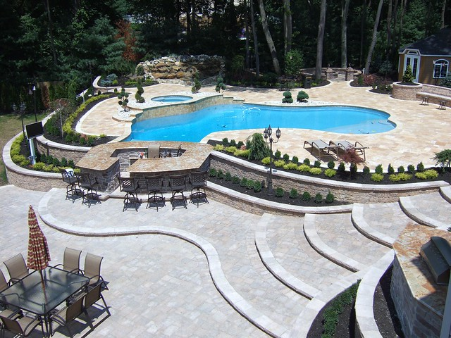 Luxury full pool and patio landscape and design with new addition