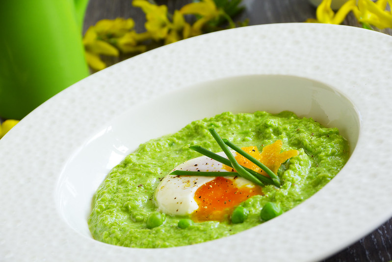 Puree the soup peas with poached egg.