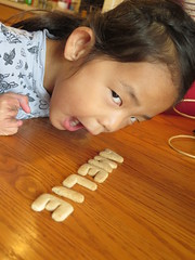 Amelie playing with Schoolhouse Cookies.
