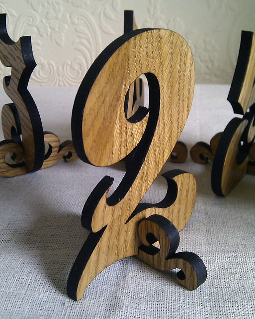 These wooden table numbers from Hanclock Designs would look great for your