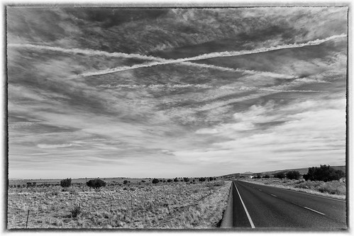 road trees sky blackandwhite bw newmexico field clouds fence landscape contrails