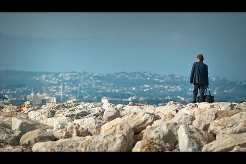 street sea man rock bag movie french nikon riviera shot candid widescreen perspective scene paca suit f2 cinematic antibes 135mm d700 fabricedrevon