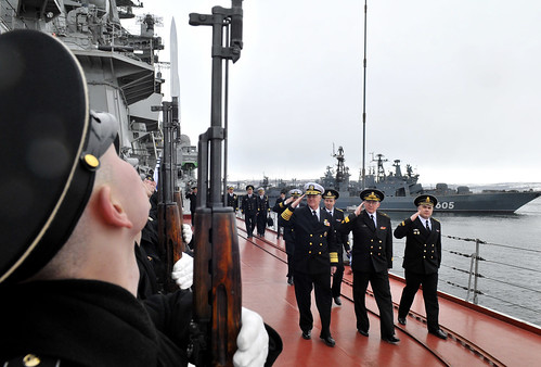 Adm. Gary Roughead renders honors before departing the Russian Navy nuclear-powered cruiser Pyotr Velikiy.