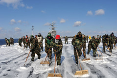 PACIFIC OCEAN (March 23, 2011) Sailors aboard the aircraft carrier USS Ronald Reagan (CVN 76) conduct a countermeasure wash down on the flight deck. Sailors scrubbed the external surfaces on the flight deck and island superstructure to remove potential radiation contamination. Ronald Reagan is operating off the coast of Japan providing humanitarian assistance as directed in support of Operation Tomodachi. (U.S. Navy photo by Mass Communication Specialist Seaman Nicholas A. Groesch/Released)