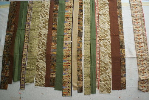 Papyrus will be a simple strip quilt. The hard part was finding the Egyptian-themed fabrics, which were out of print.  See the plan: domesticat.net/quilts/papyrus