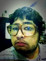 glasses(1.0), vision care(1.0), face(1.0), facial hair(1.0), man(1.0), head(1.0), hair(1.0), self-portrait(1.0), portrait(1.0), beard(1.0),