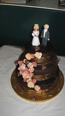 buttercream(0.0), icing(0.0), torte(0.0), cake(1.0), flower(1.0), fondant(1.0), sugar paste(1.0), food(1.0), cake decorating(1.0), birthday cake(1.0), wedding cake(1.0), cuisine(1.0),