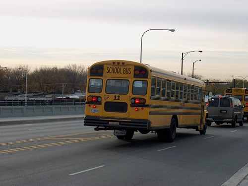 Southbound school bus crossing the North Central Avenue overpass bridge. Chicago Illinois USA. Late November 2006. by Eddie from Chicago