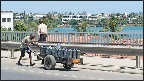 life africa city bridge man men water car town nikon traffic kenya african working hard nikkor job kenia villas mombasa pushing mombassa d700