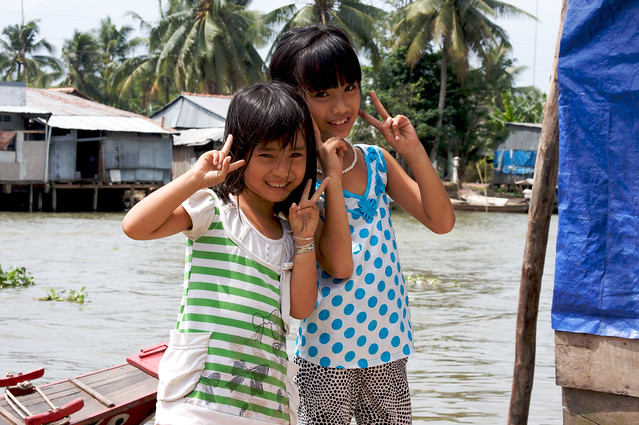 Children in Vietnam smile for the camera - Flickr CC katinalynn