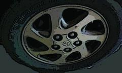 steering wheel(0.0), goaltender mask(0.0), medical imaging(0.0), wheel(1.0), rim(1.0), alloy wheel(1.0), circle(1.0), hubcap(1.0), spoke(1.0),