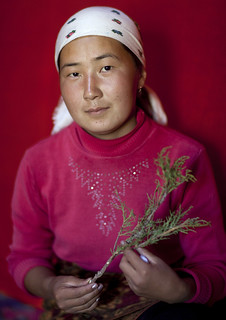 Woman With Headscarf Showing An Aromatic Herb, Jaman Echki Jailoo Village, Kyrgyzstan
