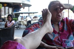 DJ smelling Jones feet in cafe in Phnom Penh