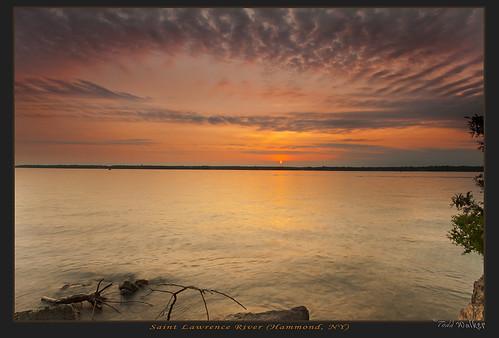 sunset sky sun canada water clouds river border stlawrence stlawrenceriver canadianborder saintlawrenceriver oakpoint colebay singhray d700 reversegrad hammondny nikon1635mm stlawrencesunset