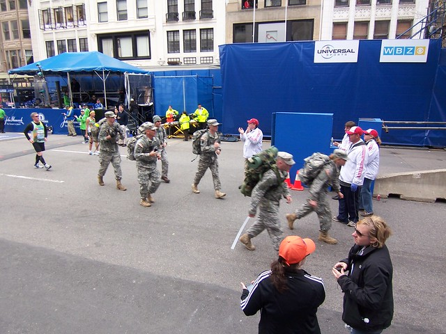 military crossing the finish line