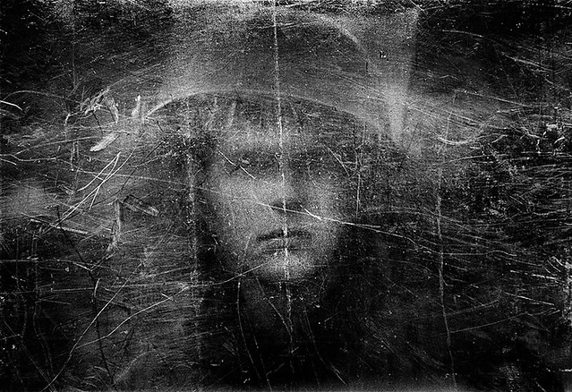 Soldier through a plexiglas shield, Northern Ireland, 1973, by Philip Jones Griffiths