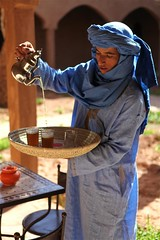 Hotel staff serving the quintessentially Moroccan mint tea, in the Desert