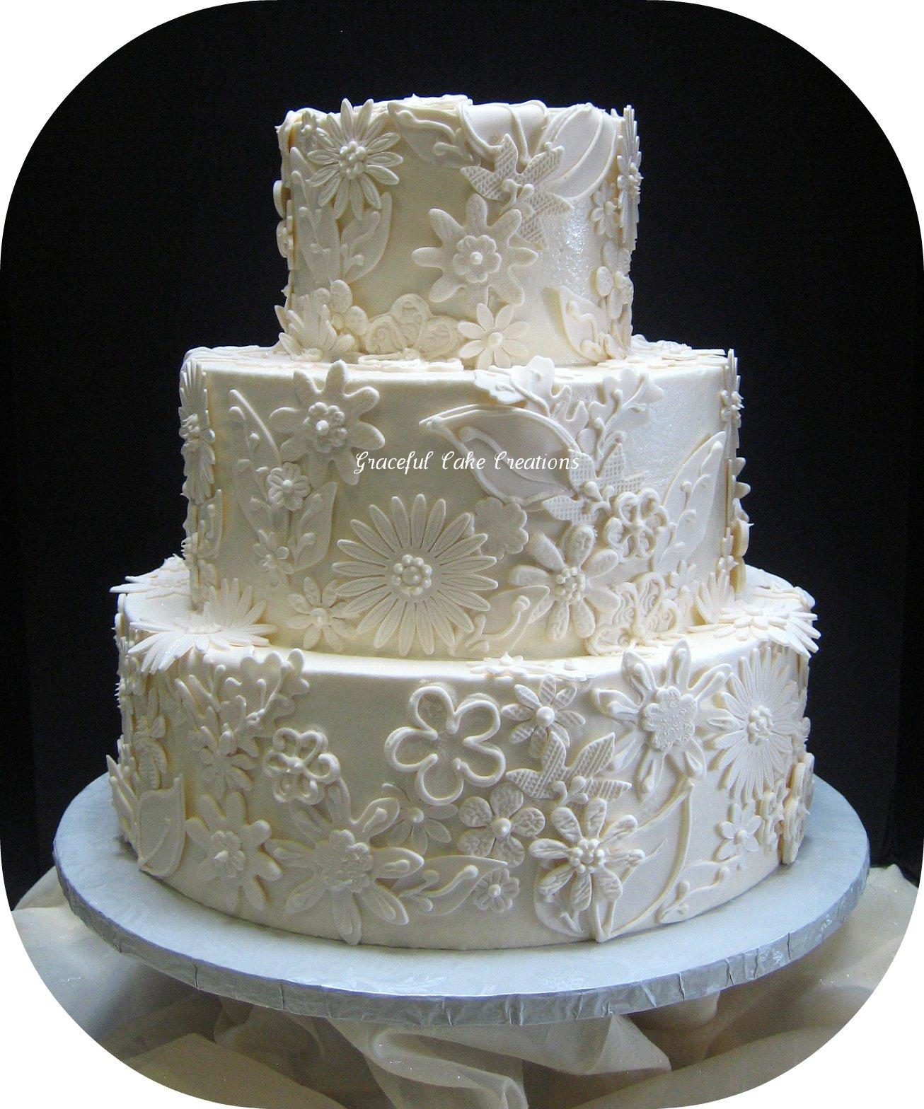 Elegant Ivory Wedding Cake with Fondant Lace Applique
