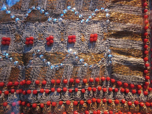 Silver and gold thread couched embroidery with red beads - Quai Branly