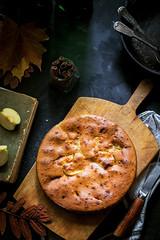 Homemade apple pie in vintage iron pan on dark bac…