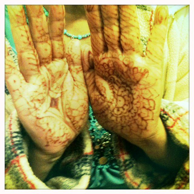 Mehendi pitcher pose- throw me a besan ladoo, I'm hungry she says