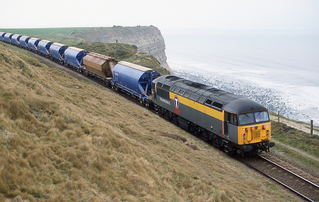 Transrail Dutch 56 049 heads along Hunts Cliff on empties returning to Boulby Mine