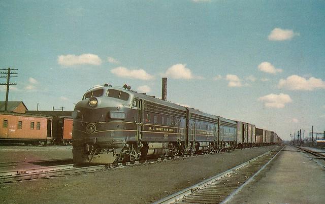 B&O0002 An A-B-B set of Electro-Motive F7's (4553 leading) in B&O classic colors bring a freight through Garret, Ind, March 1958 (Richard R. Wallin)