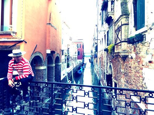 Gondolier taking a break in Venice.