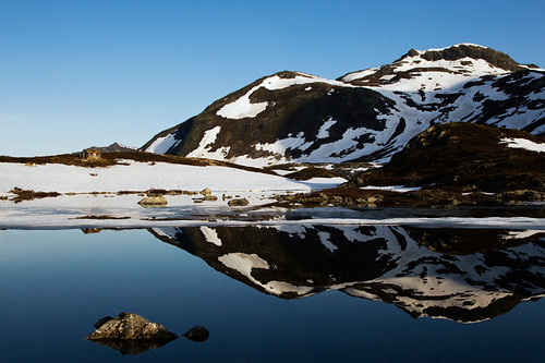 sky house mountain lake snow mountains reflection ice nature water norway rock landscape spring rocks bluewater bluesky valdres oppland snowmountains bygdin klaracolor