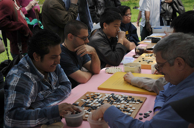 The Brooklyn Go Club both taught and played the ancient game of Go at Puzzle Plaza in the meadow. Photo by Mike Ratliff.