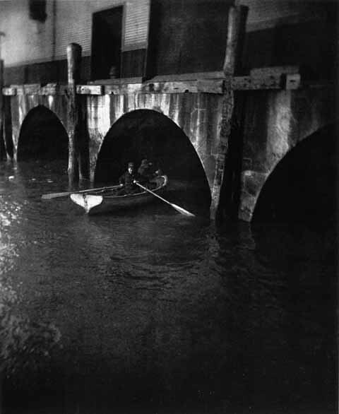 Hunting River Thieves, New York police patrol the docks by boat at night, 1890, by Jacob A. Riis