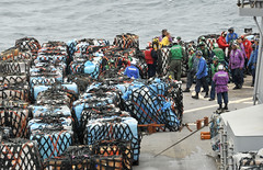 SOUTH CHINA SEA (March 21, 2011) Sailors arrange pallets on the main deck aboard 7th Fleet command ship USS Blue Ridge (LCC 19) during a vertical replenishment-at-sea with the USNS Pecos (T-AO 197). Blue Ridge transferred pallets of humanitarian assistance and disaster relief supplies to support Operation Tomodachi relief efforts in Japan. (U.S. Navy photo by Mass Communication Specialist 3rd Class Fidel C. Hart)