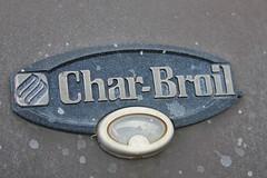 automotive exterior(0.0), wheel(0.0), number(0.0), house numbering(0.0), badge(0.0), vehicle registration plate(0.0), symbol(1.0), trademark(1.0), font(1.0), emblem(1.0),