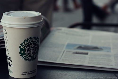 Starbucks with news paper