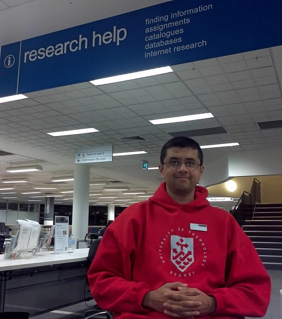 UTS Librarian in Charge - Research Helpdesk Winter Night Shift Wearing Red Hoody