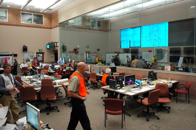 Different clusters of tables correspond to different functions supported emergency management.  Photo by Jeff Berger.