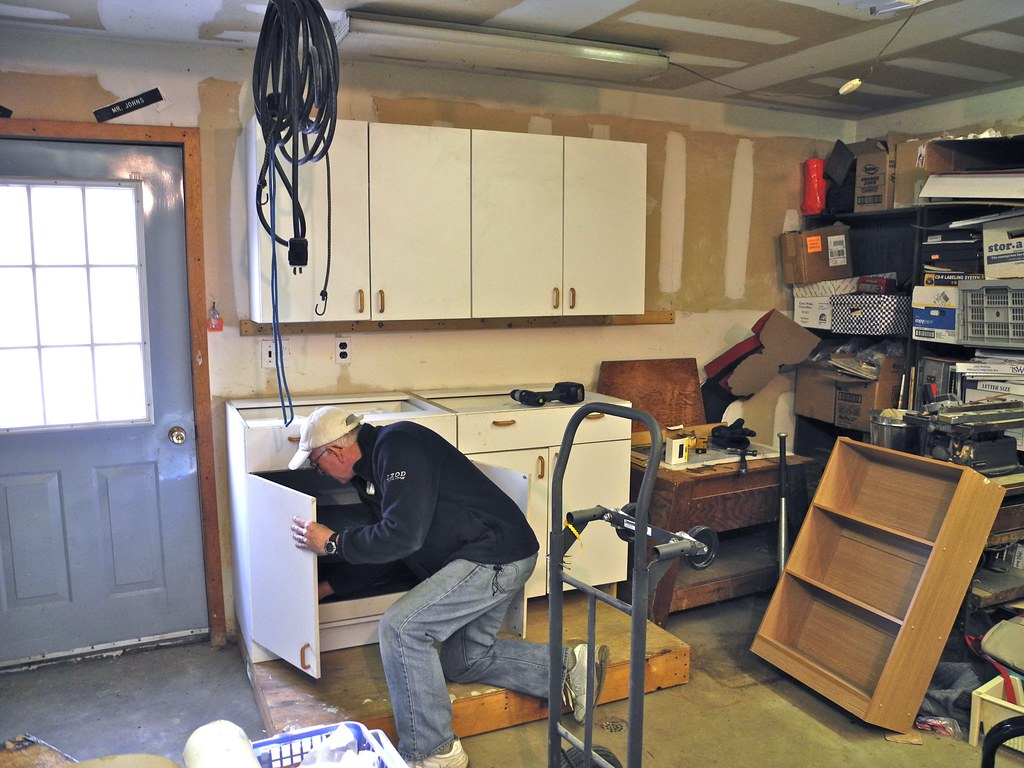 reusing the old kitchen cabinets in the garage flickr repurpose and reuse your old cabinets coast design