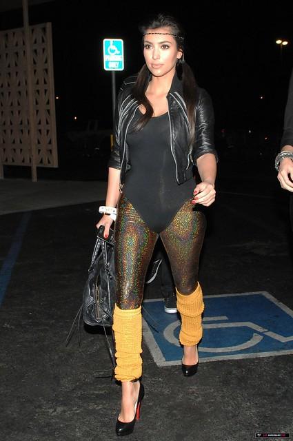 Kardashian in gold very shiny spandex metallic leggings and leotard 4