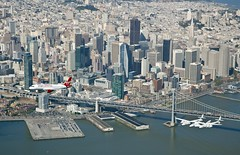 Exciting the sky line as they fly past San Francisco. Photo by Mark Greenberg
