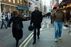 Unsuccessfully hunting a place to supper in Soho. I need to get better speed control on the rangefinder or better anticipate the light and previous settings. by JulianBleecker