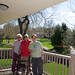 Maggie & her folks on the deck of the new house by Michael Berch