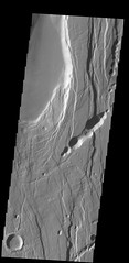 Faults and pit craters in Ceraunius Fossae (THEMIS_IOTD_20140421)