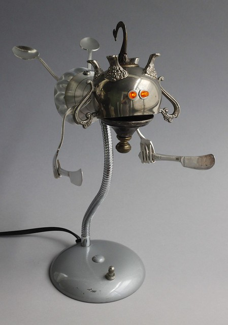 found object flying robot assemblage sculpture by Brian Marshall