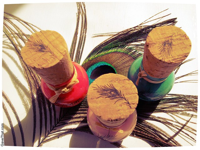 Megan Miller nail polish with lovely peacock feather plumes stamped on the wine cork handles